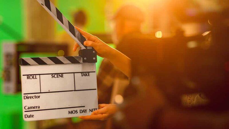 Close up Shot On Film Studio Set Young Camera Assistant Holds Em