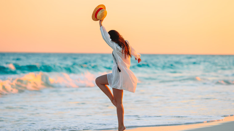 woman-jumping-on-the-beach